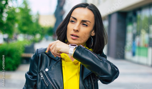 New modern technologies! A half-length photo of a young businesswoman on the street, that possesses a smartwatch, smartphone, wireless headphones Fototapet