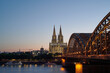 Cologne Skyline with Cologne Cathedral and Hohenzollern Bridge at after sunset