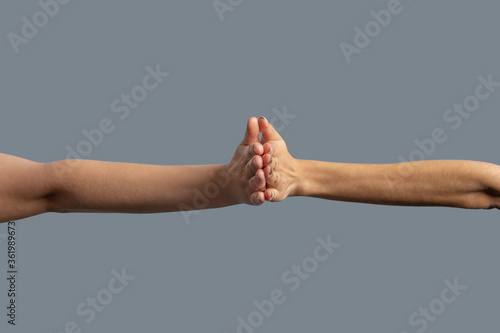 Close-up of people from different races holding palms together