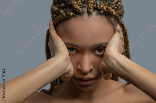 Cuadros en Lienzo Frustrated young African American woman covering her ears with hands