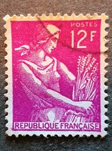 Old French Stamp With The Image Of A Woman With Ears Of Wheat