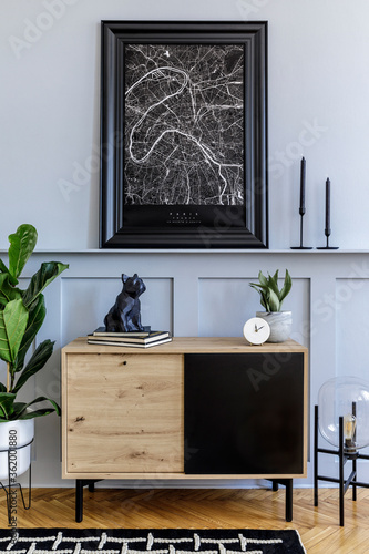Modern scandinavian home interior with mock up poster frame, design wooden commode, lamp, plants, decoration, shelf and personal accessories in stylish home decor.
