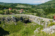 God's Bridge ( Podul Lui Dumnezeu ) - Natural Rock Bridge Formed By A Collapsed Cave On June 29, 2020 In Ponoarele. The Monument Is Visited Daily By Many Tourists.