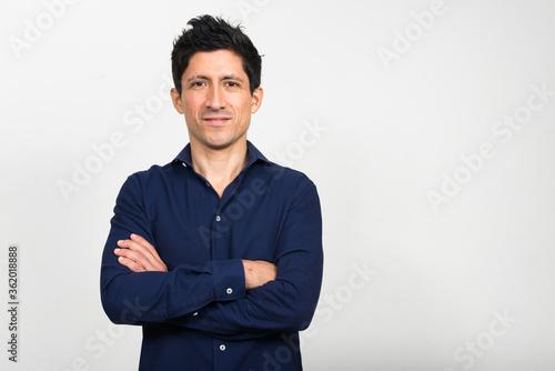 Fototapeta Portrait of Hispanic businessman with arms crossed