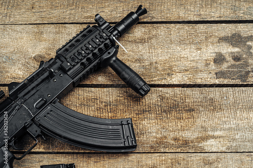 Russian automatic rifle Ak-47 close up, military weapon Wallpaper Mural