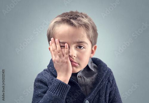 Fotografie, Tablou Boy feeling fed up, depressed, bored or stressed and showing despair