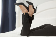 Legs Of Businesswoman Laying O...