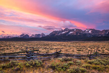 A Split Rail Fence And The Sawtooth Mountains At Sunrise Near Stanley, Idaho.