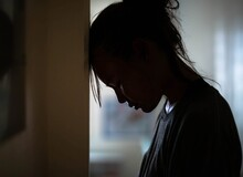 Sad Distraught Woman In Her Ro...