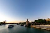 Fototapeta Paryż - Sunset over the Guadalquivir river in Seville, Andalucia, Spain.