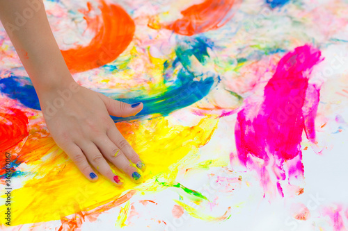 Fotografie, Tablou Happy cheerful dirty baby playing with paint on white background