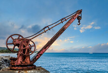 Old Red Rusty Crane By Sea At ...