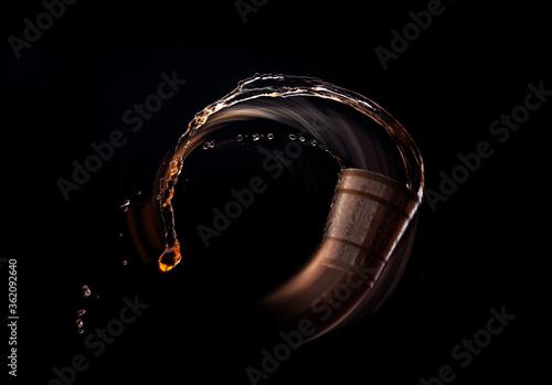 Valokuva Shot of bourbon whiskey dropping