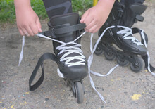 Teenager's Hands Lace Up Rolle...
