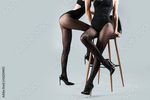 Obraz Beautiful young women in tights on grey background - fototapety do salonu