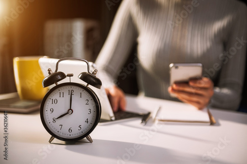 Alarm clock on the desk. Business working Wallpaper Mural
