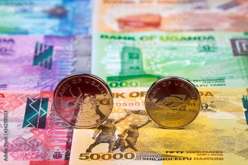 Fotografía Ugandan coins - shilling on the background of money