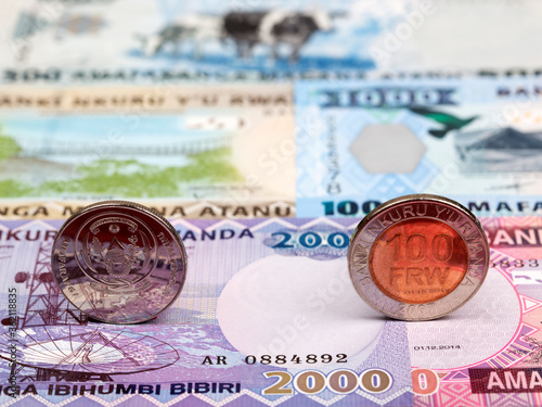 Fotomural Rwandan coins - franc on the background of money
