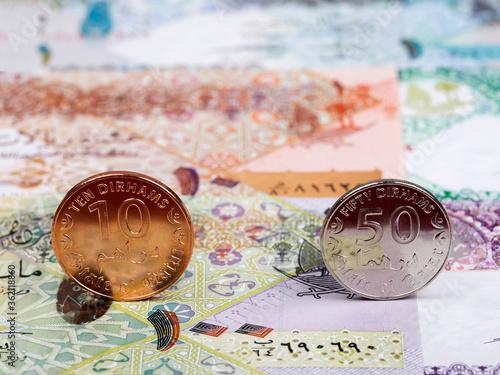 Cuadros en Lienzo Qatari coins -  riyal on the background of money