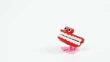 Chattering Teeth Toy Stops On The Side, White Background