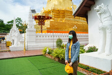 Young Asian Woman Tourist Wearing Medical Mask Come To Visit Wat Phra That Chae Haeng Temple, Located In Nan Province In Northern Of Thailand. New Normal Travel After Covid-19