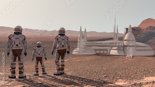 Foto Family colonists immigrants to Mars, a man, a woman and a child admire the Martian landscape, the city and spaceship