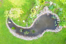 Aerial Top View Garden Pond. G...