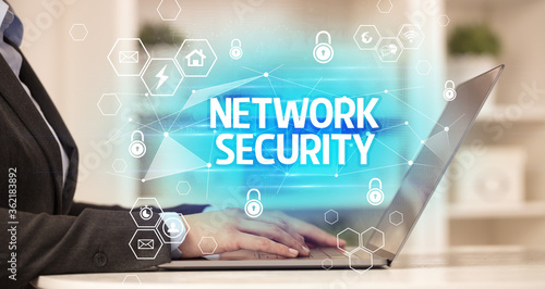 Fototapety, obrazy: NETWORK SECURITY inscription on laptop, internet security and data protection concept, blockchain and cybersecurity