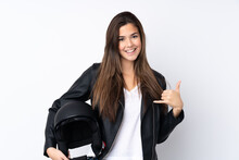 Young Woman With A Motorcycle Helmet Over Isolated White Background Making Phone Gesture