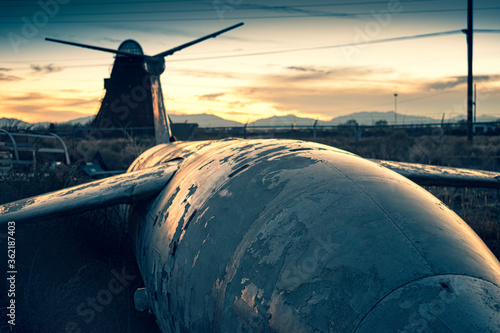 Old military airfare aircraft in a junkyard during sunset in New Mexico Canvas Print