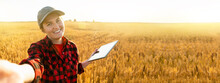 Woman Farmer With Digital Tabl...