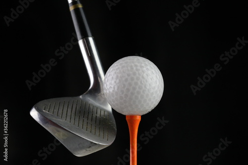 Fototapety, obrazy: Photo of a golf iron club behind the ball on the fairway