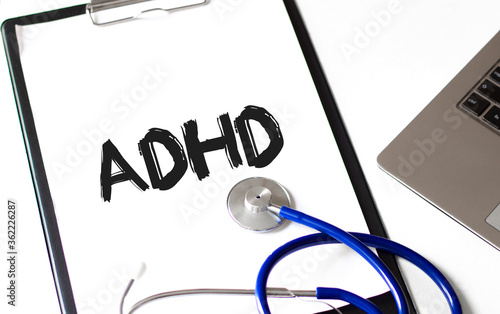 Photo Doctor holding a card with text ADHD, medical concept