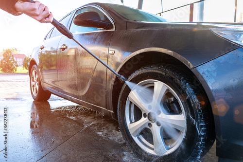 Obraz Hand clean car. Auto wash from soap, foam water service, carwash vehicle. Care with pressure wax. - fototapety do salonu