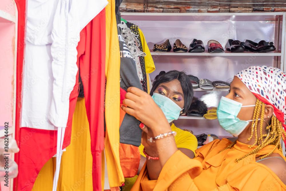 Fototapeta young african women shopping in a local shop