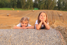 Two Children Lie At The Top Of The Haystack.