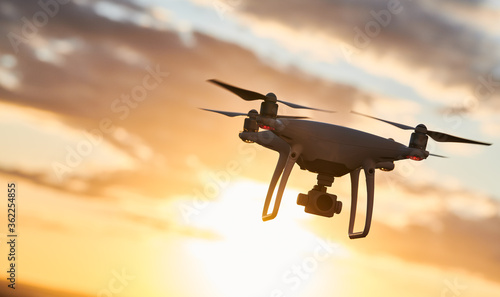 drone with digital camera flying at sunset Canvas Print