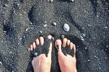 Bare Feet In The Sand At The P...