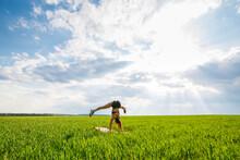 Girl Acrobat Performs A Handst...