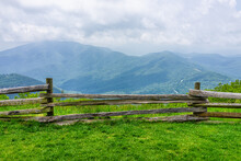 Devil's Knob Overlook Green Grass Field Meadow And Fence At Wintergreen Resort Town Village Near Blue Ridge Parkway Mountains In Summer Clouds Mist Fog Covering Rolling Hills