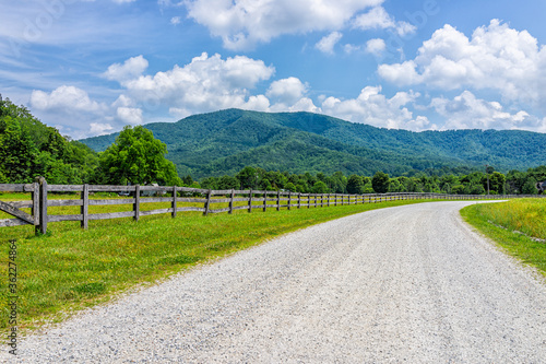 Fotografie, Tablou Farm road fence path in Roseland, Virginia near Blue Ridge parkway mountains in