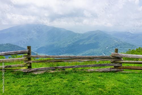 Obraz na płótnie Devil's Knob Overlook green grass field meadow and fence at Wintergreen resort t