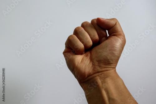 握りしめた拳のクローズアップ Tableau sur Toile