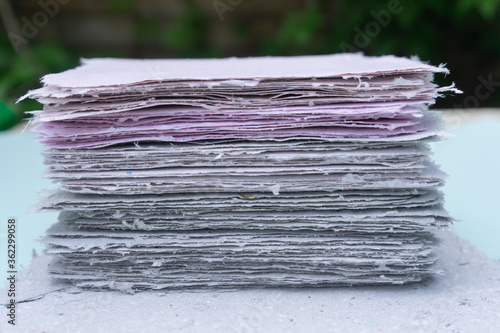 Vászonkép A stack of handmade paper. Waste paper recycling.