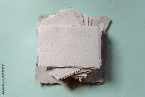Fotografering A stack of handmade paper. Waste paper recycling.