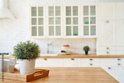 Obraz Kitchen wooden table top and kitchen blur background interior style scandinavian - fototapety do salonu