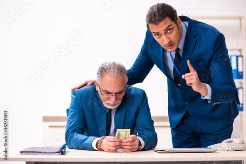 Male employee and cop in police investigation concept Canvas Print