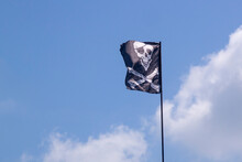 Pirate Flag Develops In The Wind, Skull With Bones, Jolly Roger