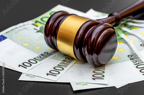 Judge's gavel with one hundred euro banknotes on black. Canvas Print