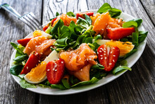 Salmon Salad - Smoked Salmon Boiled Egg And Vegetables On Wooden Background